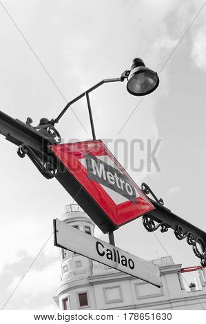 Madrid Spain - September 18 2016: Madrid Metro sign at the entrance to Callao station at Gran Via Street in Madrid. Low angle view selctive color