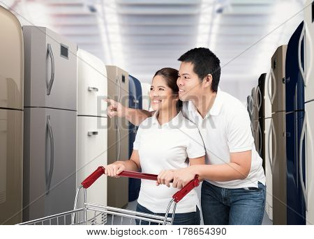 asian couple shopping refrigerator in shopping store