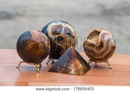 Closeup of brown concretion stone figures souvenirs