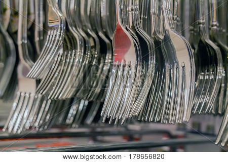 Close up of forks hanging in shop