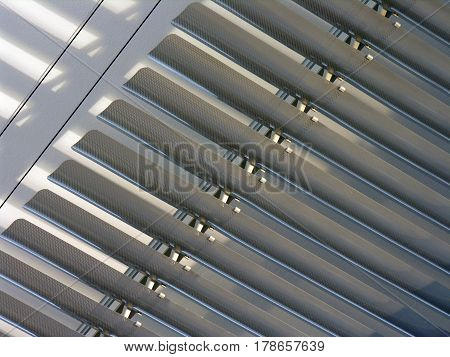 closed gray  horizontal blinds near the wall