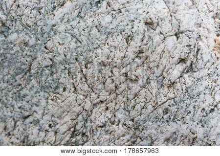 Closeup of uneven grey quartz texture background