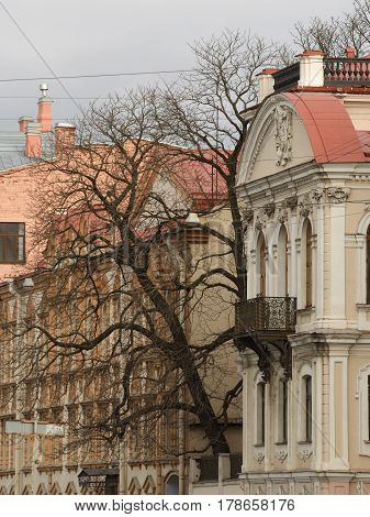 A fragment of a city street with historical architecture .