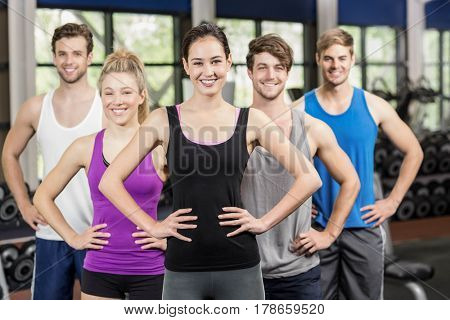Fitness class with hands on hips in gym