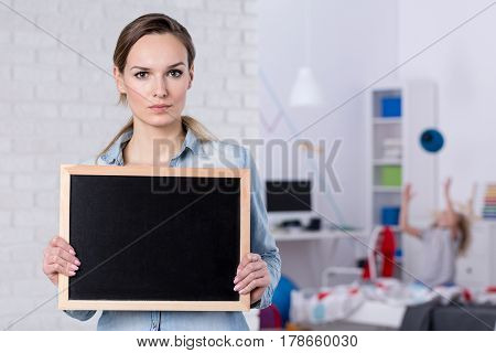 Woman Holding Small Blackboard