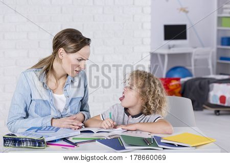 Boy Sticking Tongue At Mother