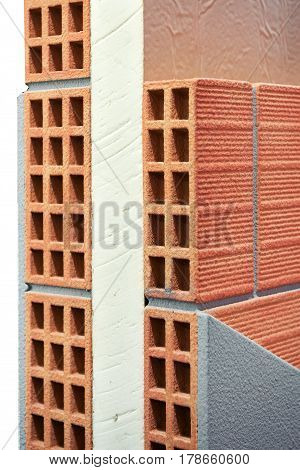Insulation Panel Between Two Layers Of Bricks