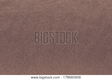 abstract background and speckled or mottled texture of fabric or textile material of brown color