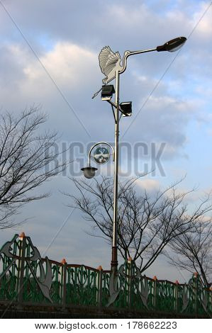 Jinju, South Korea - February 16, 2011 - Street lamp with a stork - a symbol of the city. Embankment   in February 16, 2011, Jinju, South Korea.