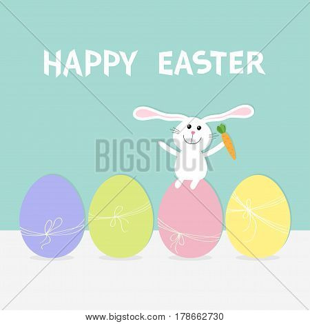 Rabbit with carrot sitting on painting egg shell set. Painted eggs with thread and bow. Happy Easter bunny. Farm animal. Cute cartoon funny character. Greeting card. Blue background Flat design Vector