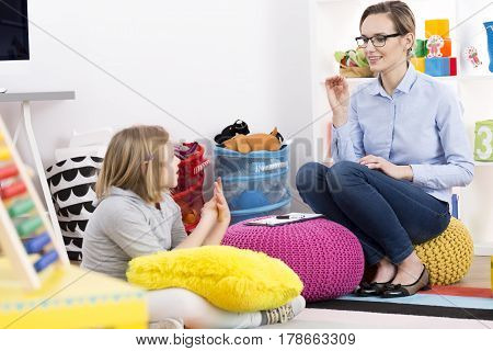 Little blond girl visiting a school psychologist
