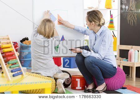 Girl Studying Maths With A Teacher