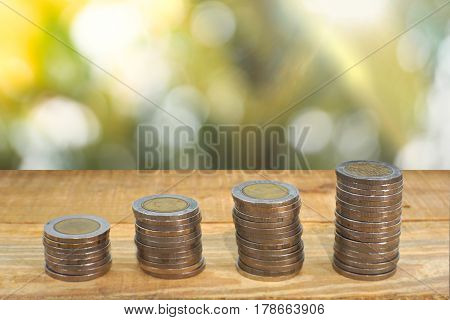Mix coins and seed in clear bottle on white background,Business investment growth concept