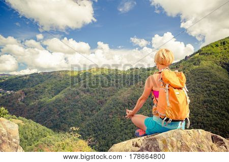 Hiking woman celebrating inspirational mountains landscape admire and meditate. Fitness and healthy lifestyle outdoors in colorful summer nature. Trekking camping and climbing travel concept.