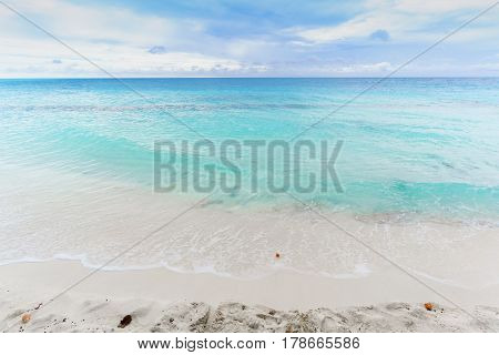 Beautiful beach and crystal clear turquoise sea in tropical Maldives island