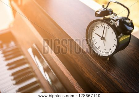 alarm clock on piano at Bangkok in Thailand