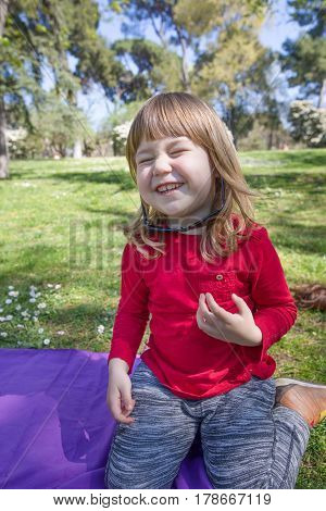 Laughing Child In Park Playing With Adult Sunglasses