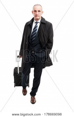 Middle Age Business Man Walking With Carry On Luggage