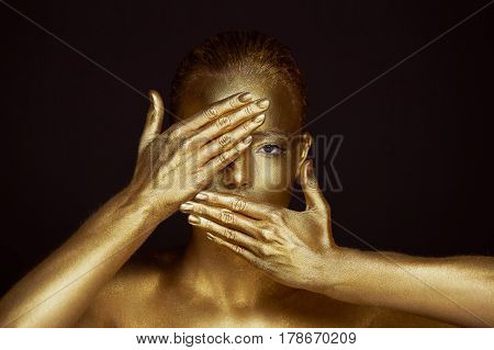 Portrait unearthly Golden girls, hands near the face. Very delicate and feminine. The eyes are open.Frame of hands