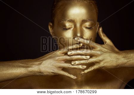 Portrait unearthly Golden girls, hands near the face. Very delicate and feminine. The eyes are closed.Frame of hands