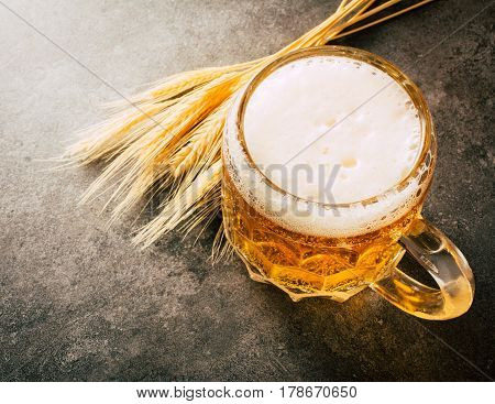 Glass of  beer on stone background with copy space. wallpaper