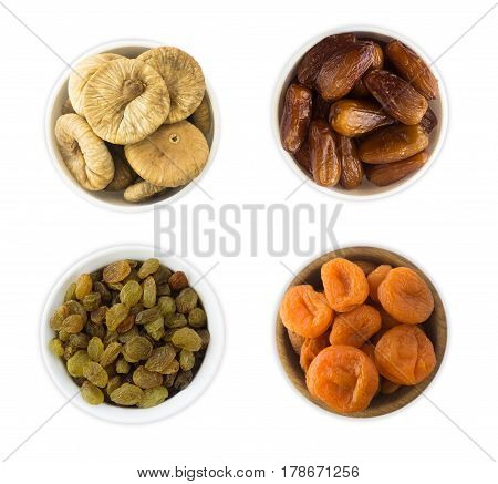 Collage of different dried fruits. Raisins dates dried apricots figs isolated on white background. Top view.