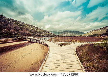 Wooden Footbridge Across Tidal River. Wilsons Promontory, Victoria, Australia.