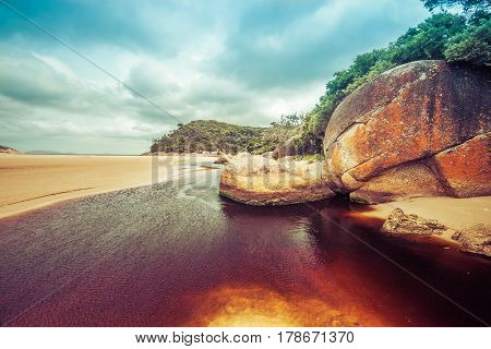 Beautiful Orange Rocks And Brown Water Of Tidal River. Wilsons Promontory, Victoria, Australia.