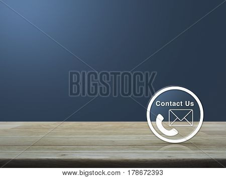 Telephone and mail icon button on wooden table over light blue gradient background Contact us concept
