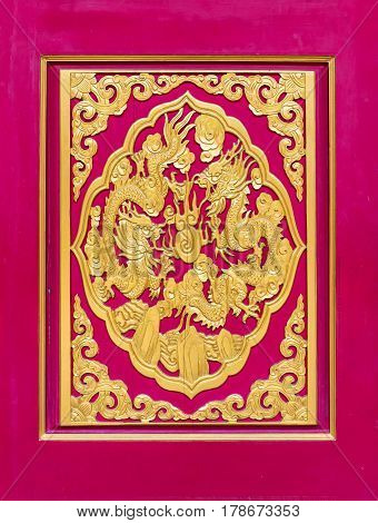 Golden dragon carved decorated on red wooden door Chinese style in Chinese templeThailand. The public domain or treasure of Buddhism no restrict in copy or use