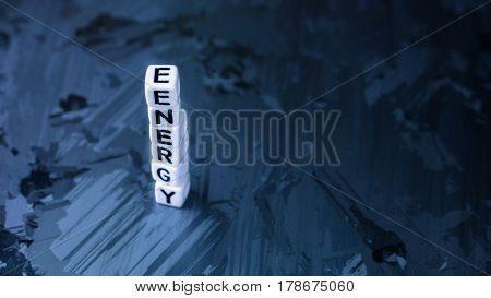 ENERGY cube letter in pile on solar silicon cell surface background. Concept of renewable clean energy.