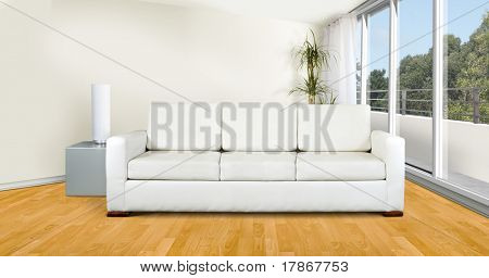 White sofa in a modern minimalist living room with a balcony