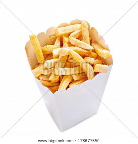 French fries in a paper bag isolated on a white background. Close up.