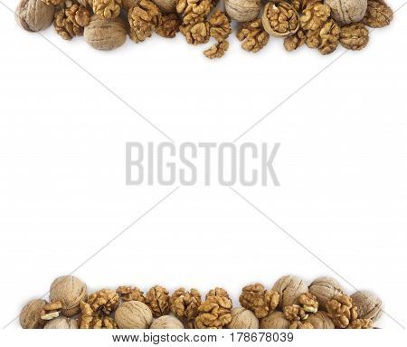 Walnuts background. Walnuts at border of image with copy space for text. Kernels walnuts on a white background. Top view.