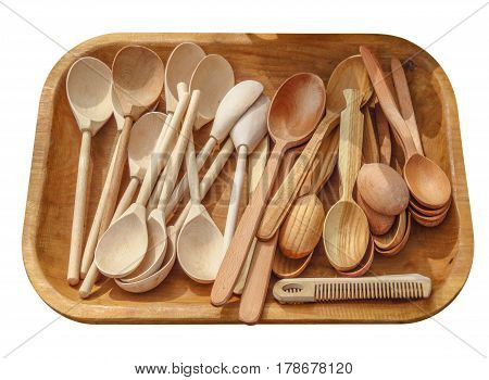 Wooden tray with spoons isolated on white. Clipping path included.