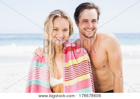Portrait of happy couple on the beach on a sunny day