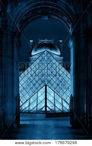 PARIS, FRANCE - MAY 13: Louvre archway closeup view on May 13, 2015 in Paris. With over 60k sqM of exhibition space, Louvre is the biggest Museum in Paris.