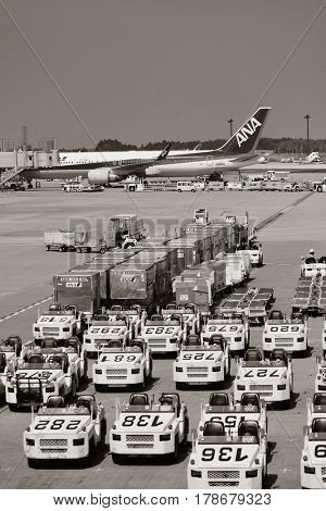 TOKYO, JAPAN - MAY 15: Airplane loading cargo at Narita airport on May 15, 2013 in Tokyo. Tokyo is the capital of Japan and the most populous metropolitan area in the world