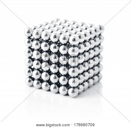 Cube toy magnetic metal spheres isolated on white background