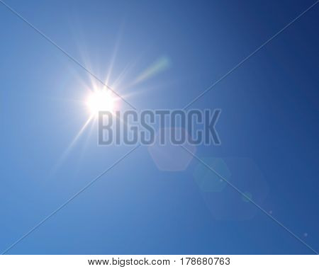 Shining sun at clear blue sky with copy space.
