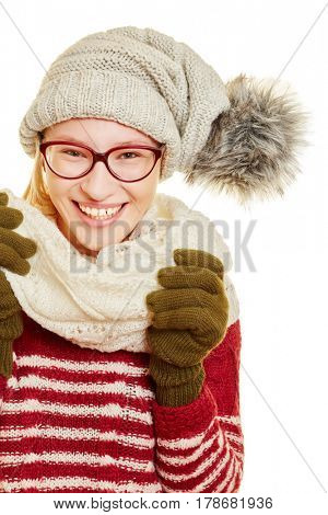 Young woman with glasses in winter with a cap and a scarf