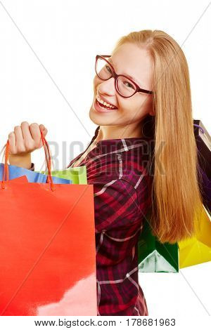 Smiling young woman with a lot of bags shopping