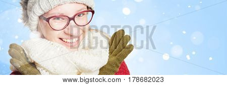 Face of a smiling woman in the snow in winter in panorama format