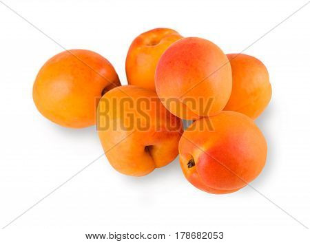 Pile of apricots isolated on white background. Closeup image of sweet fruit, healthy natural organic food for vegans and vegetarians