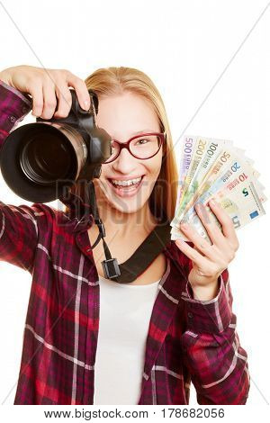 Happy woman with camera earning money with photography