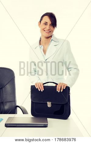 Young Attractive Business Woman With Briefcase At The Office