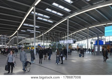utrecht netherlands 15 march 2017: many travellers inside hal of new central railway station in the netherlands