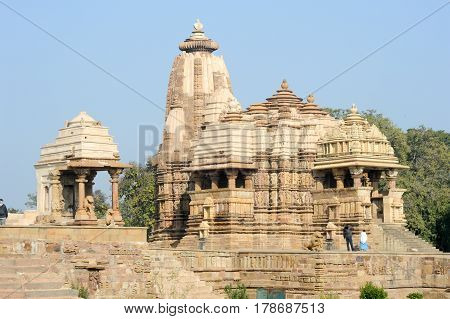 Khajuraho India - 30 January 2015: People climb to the hindu temple on UNESCO World Heritage Site Khajuraho Group of Monuments built between 950 and 1150