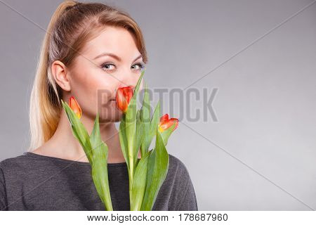 Smiling Female Holding Boquet.