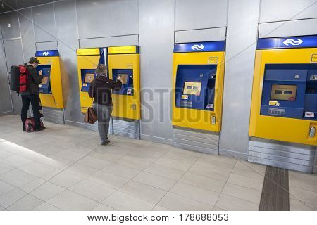 Utrecht Netherlands 15 march 2017: passengers buy tickets at machine on utrecht central station in the netherlands
